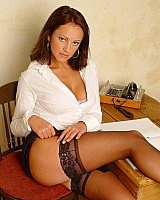Only Tease Vickie Powell in secretary outfit with specs and stockings.