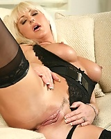 Attractive blonde Anilos babe Emilianna spreads her juicy milf pussy revealing her tantalizing pink clitoris